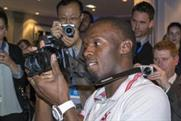 Usain Bolt gets to grips with Samsung's NX300 smart camera