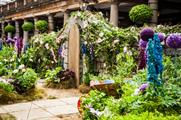 The garden featured flowers, a fountain and tree made out of clothes