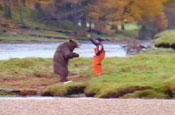 John West reprises bear v fisherman fight scene