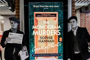 'The Monogram Murders': black and white newspaper boys promoting the new Hercule Poirot novel