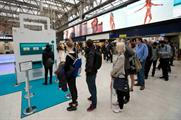 Commuters queue up for Deliveroo's slot machine game at London Waterloo