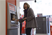 Button handed customers £100 from inside the ATM