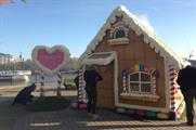 The edible gingerbread house operates as a pop-up ticket office (@ShreksAdventure)