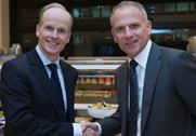 Booker CEO Charles Wilson (left) and Tesco CEO Dave Lewis (right)