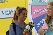 Students will 'spin to win' for the chance to enter the container and try a secret challenge for a prize