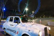 Air France's London taxi projecting laser images onto skyline