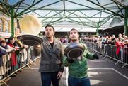 Adam Richman joins in Better Bankside's pancake day race