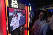 Avid gamers try out EA Sports Madden NFL 15 at the NFL Super Bash