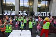 Children join Greenpeace in playful protest stunt