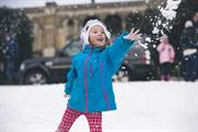 Kids and families enjoy the snow, created by Land Rover at Alexandra Palace