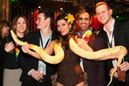 Guests with a snake charmer at the Late Night London showcase