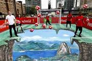 Michael Owen shows off football skills on Coca-Cola's 3D artwork