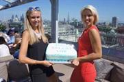 Bimla Safka (right) celebrates Smart Live's first birthday with team and suppliers