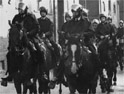 Mounted riot police head for Wapping