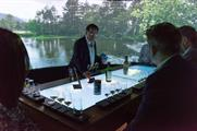 A brand ambassador guides guests through the digital, interactive table
