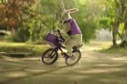 The new campaign features the mysterious purple-clad Easter Bunny