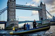 McBride was sailed in a speedboat down the Thames with Milk Tray in hand