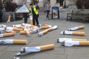 Giant cigarettes draw attention from crowds