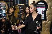 Guests drank black and gold Tanqueray cocktails at the launch event