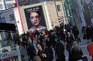 """Look at me. We can stop it."" As passers-by looked at the ad, rather than walking by, pioneering gaze recognition technology made the bruises on the woman's face disappear."