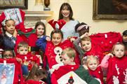 Samantha Cameron helps out on Save the Children's Christmas Jumper Day