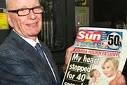 Rupert Murdoch with the launch edition of The Sun on Sunday