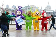 Young and old passers by came in for hugs with the Teletubbies (Rex)