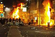 London riots: more than 100 people arrested