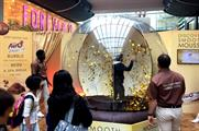 Shoppers are challenged to grab as many gold discs as they can within 30 seconds