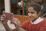 A vacationer becomes the village photographer in iPhone 7 spot