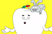 A giant, talking molar tells the 'Inconvenient Tooth' about toothpaste