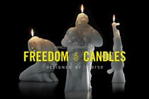 Amnesty International burns candles to illuminate new hope