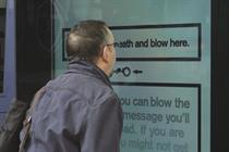 Cancer Research UK invites smokers to puff into bus shelter