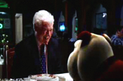 Churchill dog shares curry with Roy Walker