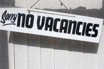Junior job market facing 'crisis' as companies hit brake on hiring