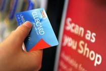 Tesco profits down 24% as rival Sainsbury's edges ahead