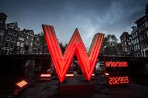 Global: W Hotels floats giant 'W' down Amsterdam canal