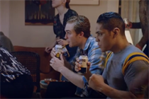 Corona Extra throws punches in first dual-language spots