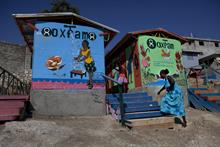 Oxfam to withdraw from 18 countries and cut nearly 1,500 jobs