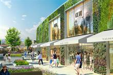 Why did an outlet retail company commission Europe's largest living wall?