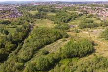What skills are needed to transform a former council tip into a self-sustaining eco park?