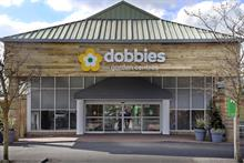 What impact will Dobbies' purchase of  31 Wyevale outlets have on the garden centre industry?