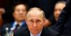 Putin talks fondly of 'free spirited' hackers, denies interference