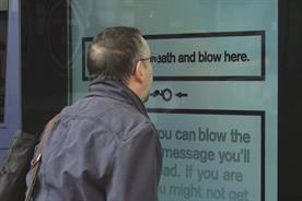 Cancer Research UK interactive poster asks passersby to 'blow here'