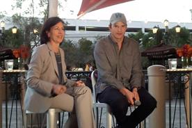 Ashton Kutcher (right) with with OMD CEO Monica Karo.