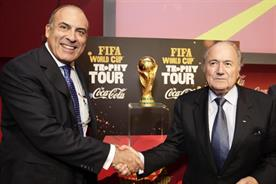 2022 World Cup: Coke's chairman Muhtar Kent shakes hands with FIFA president Sepp Blatter.