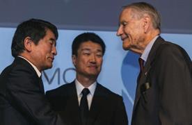 Yukio Okamoto, outside board member of Mitsubishi Materials and Hikaru Kimura, senior executive officer Mitsubishi Materials, offer an apology to 94-year-old US prisoner of war, James Murphy.