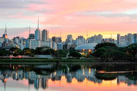Getty: Skyline with reflections on lake at sunrise, Ibirapuera Park, São Paulo, Brazil.