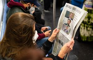 Traditional print titles, such as The Wall Street Journal, are read by key decision-makers, so they remain powerful platforms for message pull-through. (Photo by Robert Nickelsberg/Getty Images)