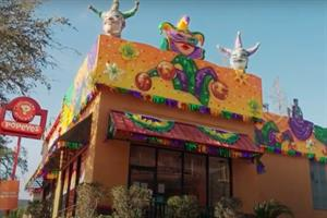 Why Popeyes turned its restaurants into Mardi Gras floats
